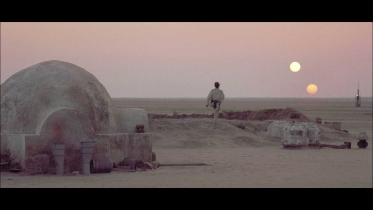 A photo of Luke Skywalker looking at two suns set on Tattooine